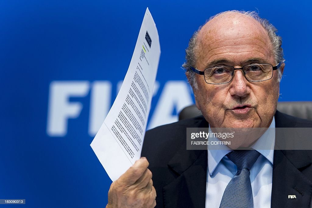 President <a gi-track='captionPersonalityLinkClicked' href=/galleries/search?phrase=Sepp+Blatter&family=editorial&specificpeople=209372 ng-click='$event.stopPropagation()'>Sepp Blatter</a> gestures as he speaks during a press conference on October 4, 2013 at the FIFA headquarters in Zurich. Claims that migrant workers are treated like slaves in 2022 World Cup host Qatar were centre stage as the global football's governing body FIFA met behind closed doors.