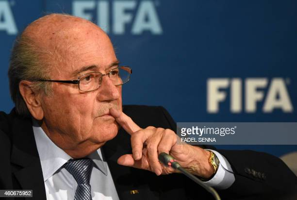 FIFA president Sepp Blatter gestures during a press conference on December 19 2014 in the Moroccan city of Marrakesh top US lawyer Michael Garcia...