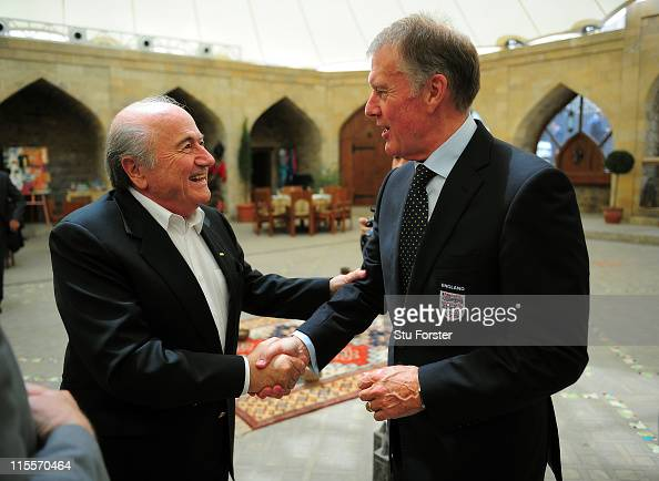 FIFA president Sepp Blatter greets England 1966 World Cup Final player Sir Geoff Hurst during celebrations to mark 100 years of Football in...