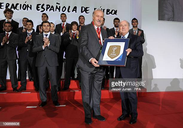 President Sepp Blatter hands over the FIFA World Champions Badge to Spanish Head coach Vicente del Bosque on November 15 2010 in Madrid Spain