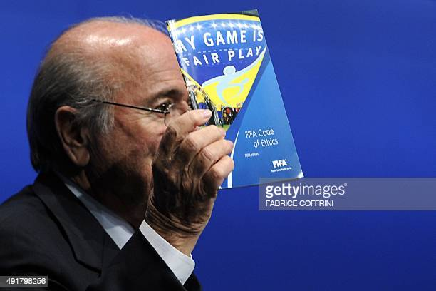 President Sepp Blatter holds the FIFA Code of Ethics during a press conference on May 30 2011 at the FIFA headquarters in Zurich The football's world...