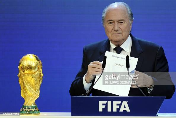 President Sepp Blatter holds up the name of Qatar during the official announcement of the 2022 World Cup host country on December 2 2010 at the FIFA...