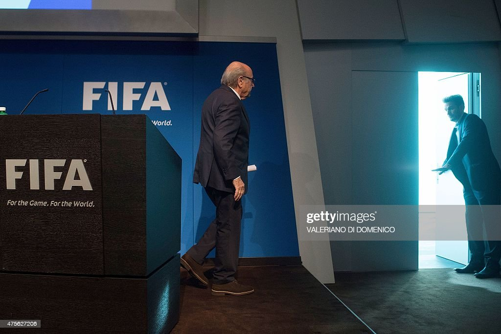 President Sepp Blatter leaves after a press conference at the headquarters of the world's football governing body in Zurich on June 2, 2015. Blatter resigned as president of FIFA as a mounting corruption scandal engulfed world football's governing body. The 79-year-old Swiss official, FIFA president for 17 years and only reelected days ago, said a special congress would be called to elect a successor..