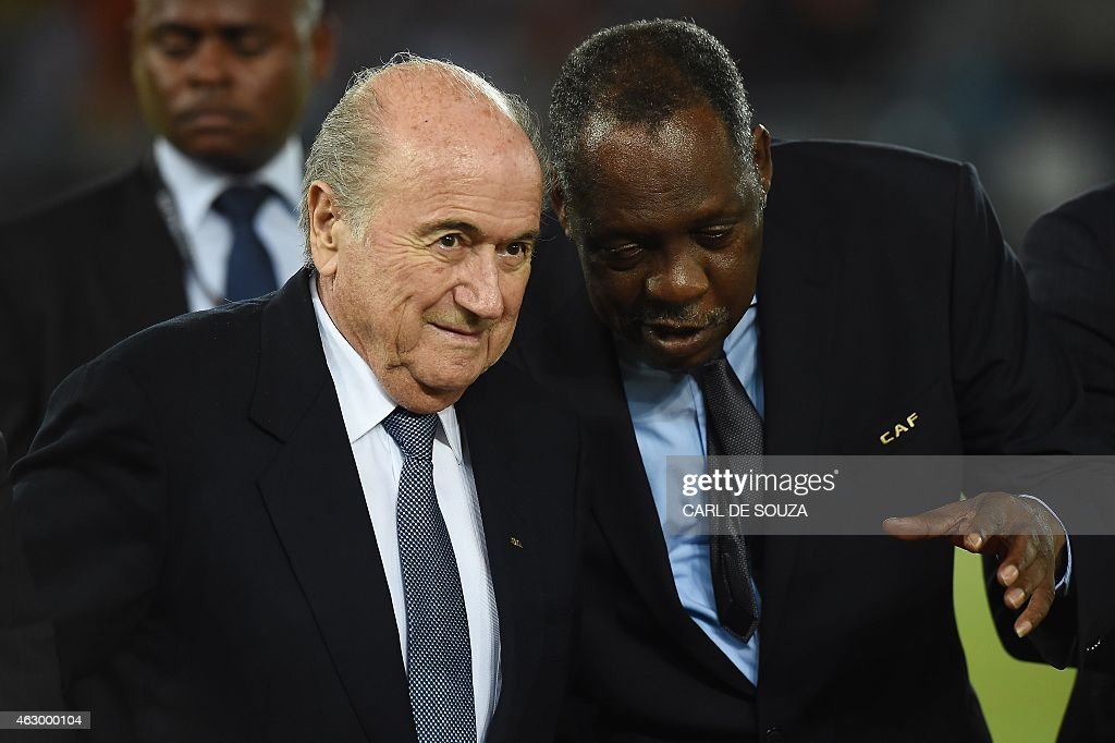 FIFA president Sepp Blatter listens to Confederation of African Football president Issa Hayatou during the 2015 African Cup of Nations final football...