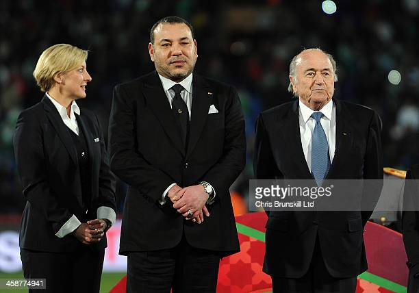 President Sepp Blatter looks on next to Morocco's King Muhammad VI following the FIFA Club World Cup Final match between Bayern Muenchen and Raja...