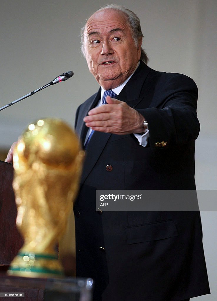 FIFA president Sepp Blatter points towards the official FIFA World Cup trophy as he speaks during a press briefing at the presidential guest house in Pretoria on June 6, 2010 five days before the kick off of the World Cup football tournament. The 2010 World Cup will take place in South Africa from June 11 to July 11, the first time on African soil for the biggest and most prestigious competition in sport.