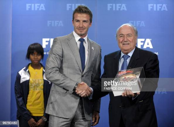 FIFA president Sepp Blatter poses after receiving the bid books for 2018 and 2022 FIFA World Cups from former England football captain David Beckham...