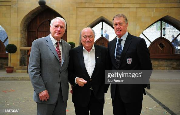 FIFA president Sepp Blatter poses for a picture with West Germany's 1966 World Cup Final goalkeeper Hans Tilkowski and England hat trick hero Sir...