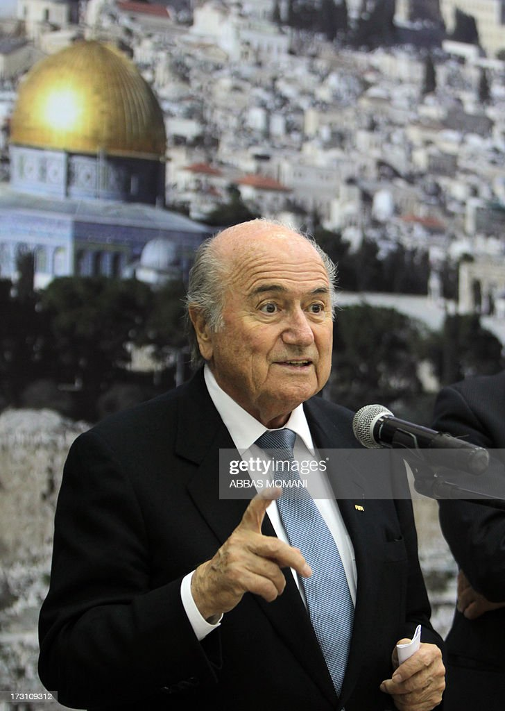 President Sepp Blatter speaks as President of the Palestinian Football Federation Jibril Rajoub (unseen) listens on in the West Bank city of Ramallah on July 7, 2013. Blatter is on a four-day-official visit to the Palestinian territories and Israel and neighboring Jordan during which he will notably launch football turf fields.