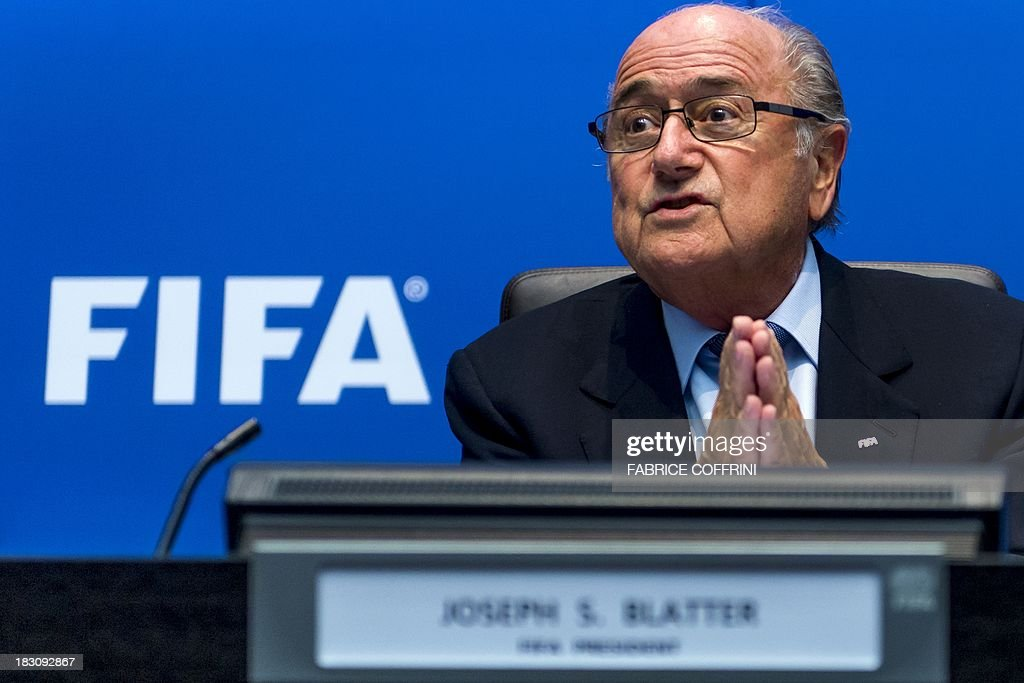President Sepp Blatter speaks during a press conference on October 4, 2013 at the FIFA headquarters in Zurich. FIFA said they could not get involved in labour issues in any country, amid calls for action after claims that dozens of migrant workers had died on construction projects linked to the 2022 World Cup in Qatar. Blatter, however said that the federation could not turn a blind eye to the reports, which also alleged that thousands of other workers endured conditions akin to 'modern-day slavery' in Qatar.