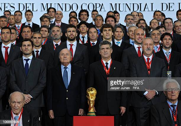 President Sepp Blatter stands with the President of the Spanish Football Federation Angel Maria Villar goalkeeper Iker Casillas and the Head Coach of...