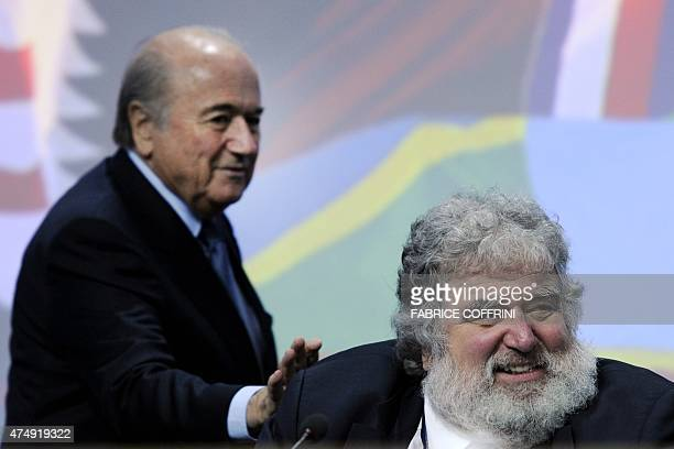 President Sepp Blatter taps shoulders of the generalsecretary of the Caribbean North and Central American Chuck Blazer the US official whose claims...