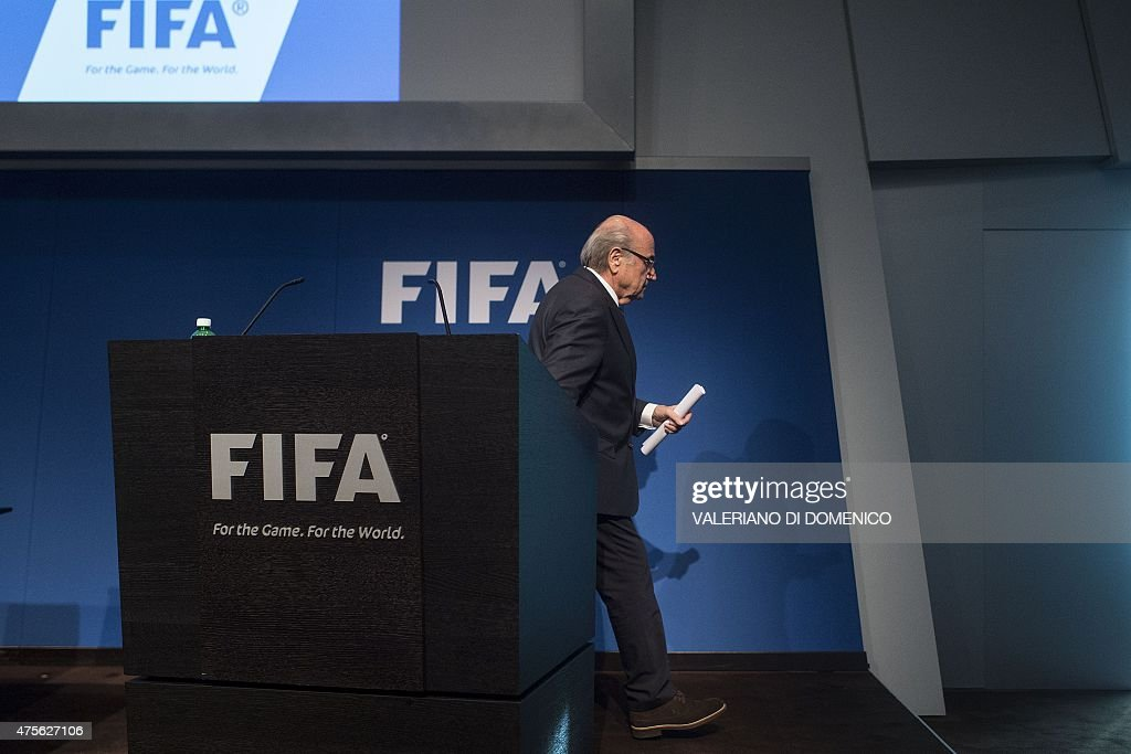 President Sepp Blatter walks after a press conference at the headquarters of the world's football governing body in Zurich on June 2, 2015. Blatter resigned as president of FIFA as a mounting corruption scandal engulfed world football's governing body. The 79-year-old Swiss official, FIFA president for 17 years and only reelected days ago, said a special congress would be called to elect a successor.