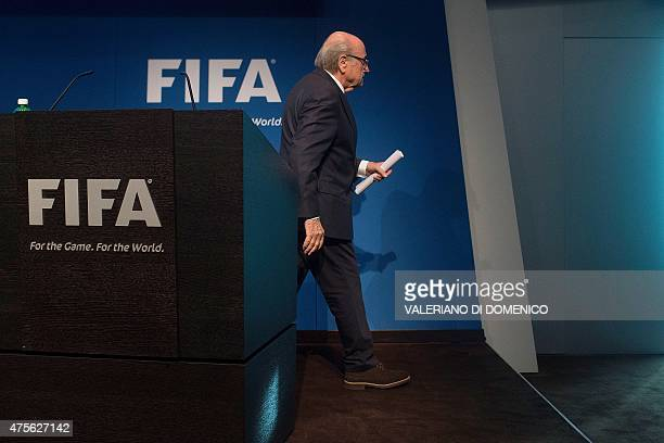 President Sepp Blatter walks after a press conference at the headquarters of the world's football governing body in Zurich on June 2 2015 Blatter...