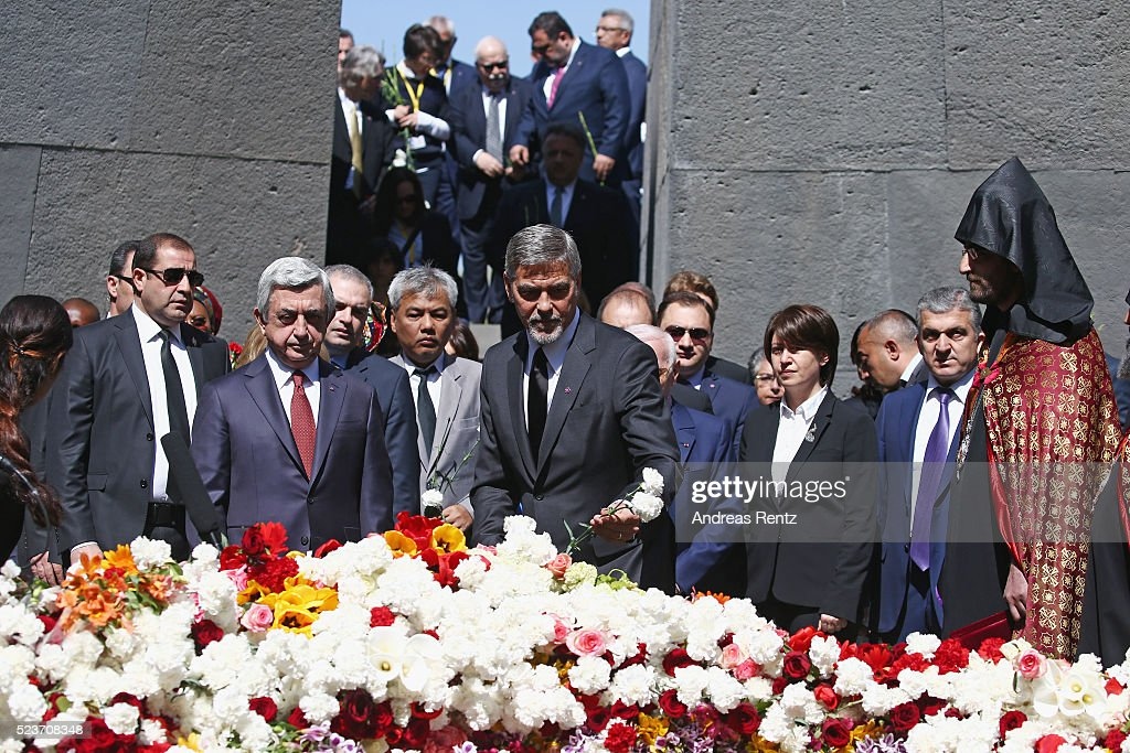 President <a gi-track='captionPersonalityLinkClicked' href=/galleries/search?phrase=Serzh+Sargsyan&family=editorial&specificpeople=4583219 ng-click='$event.stopPropagation()'>Serzh Sargsyan</a> and actor <a gi-track='captionPersonalityLinkClicked' href=/galleries/search?phrase=George+Clooney&family=editorial&specificpeople=202529 ng-click='$event.stopPropagation()'>George Clooney</a> attend the laying of the flowers at the Genocide Memorial in Yerevan, Armenia for the 101st anniversary of the Armenian Genocide on April 24, 2016 in Yerevan, Armenia.