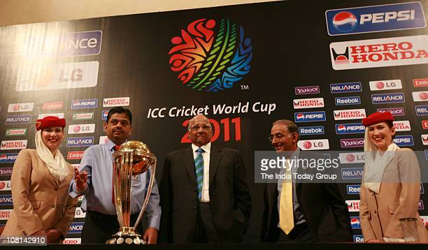 President Sharad Pawar and ICC CEO Haroon Logart pose with the ICC World Cup 2011 trophy in an event to initiate the 30day countdown to the world cup...