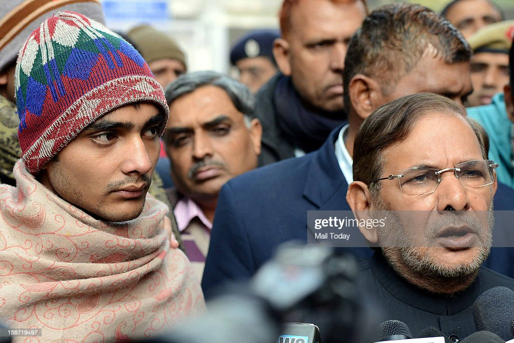 President Sharad Yadav talks to media on the death of police constable Subhash Chand Tomar, injured during Sunday massive protest against gangrape, outside the mortuary of a hospital in New Delhi on Tuesday. Tomar son is seen on the left.