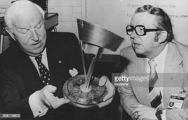 President Sir Stanley Rous and Hermann Neuberger Chief of the World Championship Orgainisation Committee inspecting the Fair Play Cup prior to the...