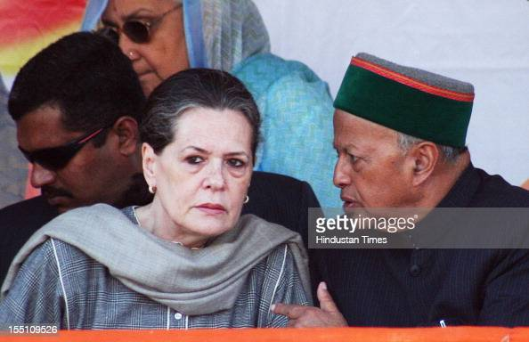 President Sonia Gandhi speaks with Himachal Pradesh Congress chief Virbhadra Singh during an elelction rally on October 30 2012 in Kangra India...