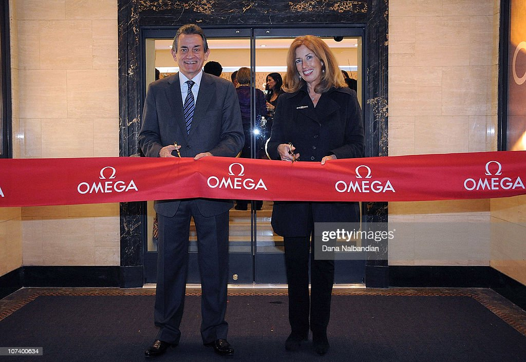 President Stephen Urquhart and Seattle Art Museum Vice Director Maryann Jordan cut the ribbon at the opening party at OMEGA Boutique on December 7...