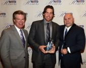 President Steve Tolman and Nashville Predators Head Coach Barry Trotz present NHL Nashville Predators player Mike Fisher with his NATD Award during...