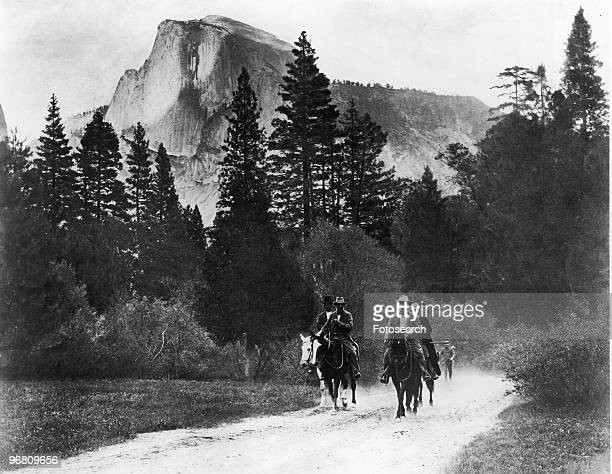 President Theodore Roosevelt and friends on horseback riding through mountain path circa 1908