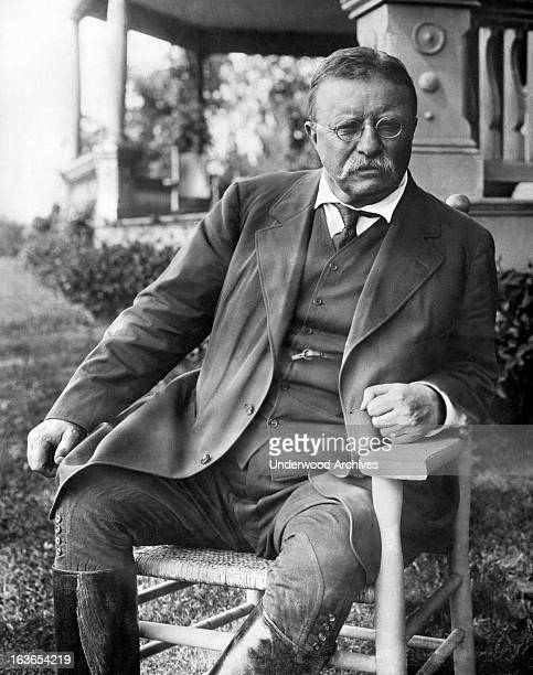 President Theodore Roosevelt seated in a chair outside his Sagamore Hill home on Long Island Cove Neck New York circa 1907