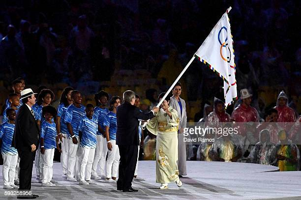 President Thomas Bach and Governor of Tokyo Yuriko Koike participate in the Flag Handover Ceremony during the Closing Ceremony on Day 16 of the Rio...