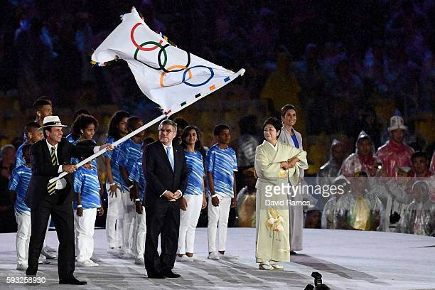 President Thomas Bach and Governor of Tokyo Yuriko Koike stand on stage for the Flag Handover Ceremony during the Closing Ceremony on Day 16 of the...