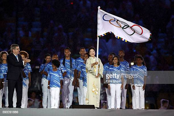IOC President Thomas Bach and Governor of Tokyo Yuriko Koike take part in the Flag Handover Ceremony during the Closing Ceremony on Day 16 of the Rio...