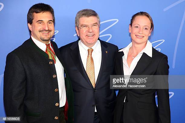 President Thomas Bach attends with Georg Hackl and and Isabell Werth his Birthday party at Stadthalle on January 10 2014 in Tauberbischofsheim Germany