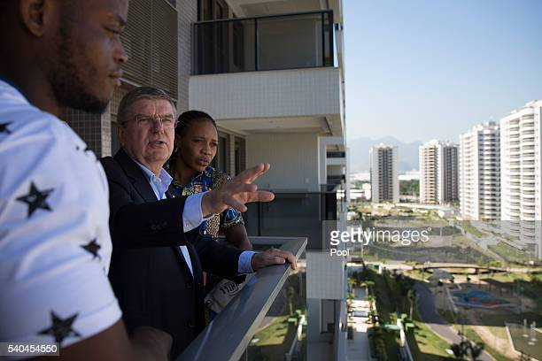 President Thomas Bach center talks with refugees and judo athletes from the Democratic Republic of Congo Yolande Mabika right and Popole Misenga as...