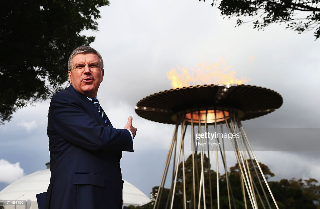 IOC President <a gi-track='captionPersonalityLinkClicked' href=/galleries/search?phrase=Thomas+Bach&family=editorial&specificpeople=610149 ng-click='$event.stopPropagation()'>Thomas Bach</a> poses in front of the Olympic Cauldron from the Sydney 2000 Olympic Games at ANZ Stadium on April 29, 2015 in Sydney, Australia.