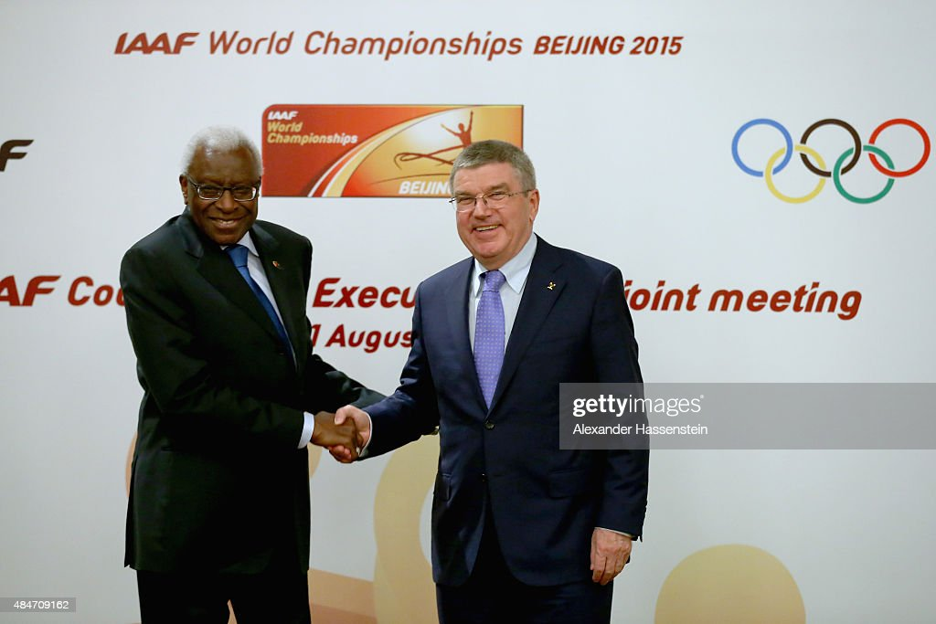 President Thomas Bach poses with IAAF President Lamine Diack (L) after the media during a press conference after the IAAF Council and IOC Executive Board meeting at Intercontinental Beijing Beichen Hotel on August 21, 2015 in Beijing, China.