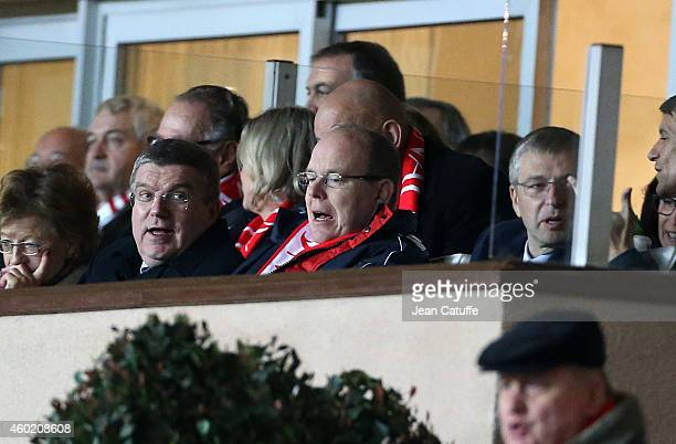 President Thomas Bach Prince Albert II of Monaco and AS Monaco President Dmitri Rybolovlev attend the UEFA Champions League Group C match between AS...