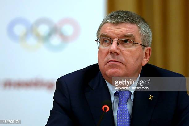 President Thomas Bach talks to the media during a press conference after the IAAF Council and IOC Executive Board meeting at Intercontinental Beijing...