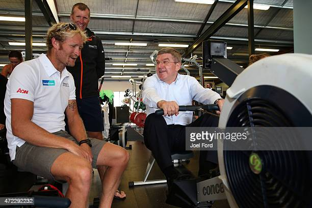President Thomas Bach tries a rowing machine while rowers New Zealand rowers Eric Murray and Mahe Drysdale watch on during a visit to the New Zealand...