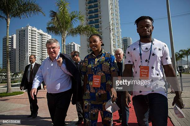 President Thomas Bach walks with refugees and judo athletes from the Democratic Republic of Congo Yolande Mabika and Popole Misenga as they visit an...