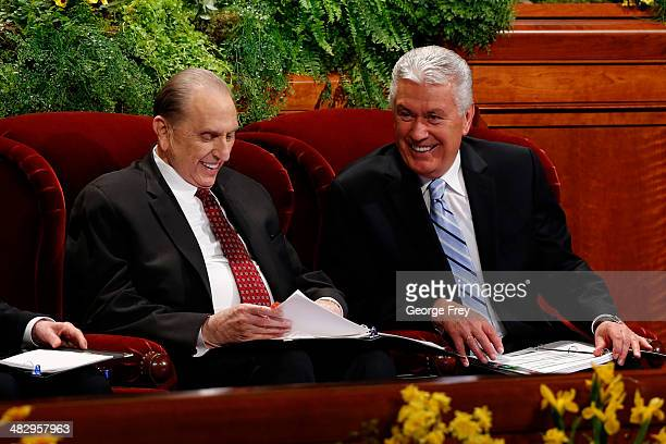 President Thomas Monson and Second Counselor Dieter Uchtdorf share a light moment before the start of the second session of the 184th annual general...