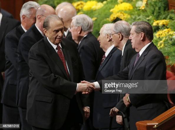 President Thomas Monson shakes the hands of Mormon Apostles as he leaves the second session of the 184th annual general conference of The Church of...