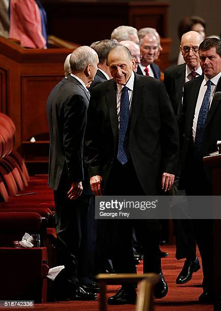 President Thomas Monson walks past the Mormon Twelve Apostles as he enters the Conference Center for the start of the 186th Annual General Conference...