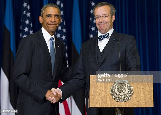 President Toomas Hendrik Ilves of Estonia and US President Barack Obama shake hands after a joint press conference at the Bank of Estonia in Tallinn...