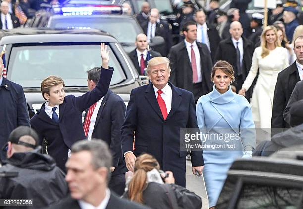 President Trump and First lady Melania Trump walk the Inaugural Parade with their son Barron Trump in Washington DC on January 20 2017