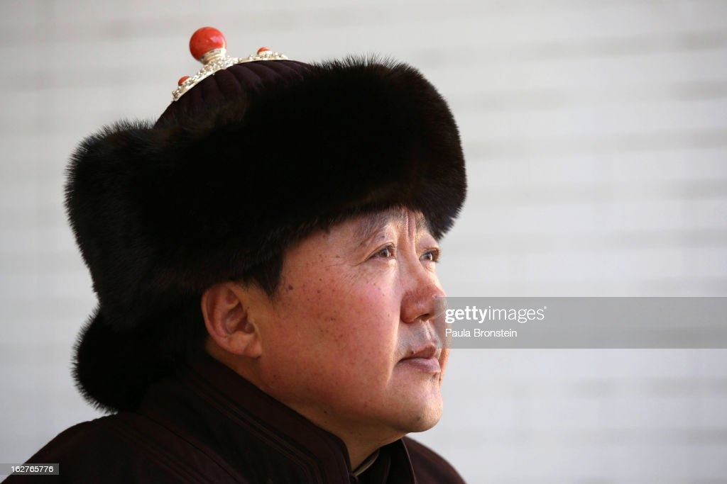 President <a gi-track='captionPersonalityLinkClicked' href=/galleries/search?phrase=Tsakhiagiin+Elbegdorj&family=editorial&specificpeople=5427078 ng-click='$event.stopPropagation()'>Tsakhiagiin Elbegdorj</a> poses wearing a traditional Mongolian hat outside the presidential residence on October 26, 2012 in Ulaanbataar, Mongolia. President <a gi-track='captionPersonalityLinkClicked' href=/galleries/search?phrase=Tsakhiagiin+Elbegdorj&family=editorial&specificpeople=5427078 ng-click='$event.stopPropagation()'>Tsakhiagiin Elbegdorj</a> was elected on May 25, 2009, having previously served two terms as Prime Minister and holding the positions of Deputy Speaker and Majority Leader in Parliament. The First Lady, Bolormaa Khajidsuren, is a mother of 4 children, and the extended Presidential family includes 20 foster children coming from a variety of government children's homes. Some 100 years ago, Mongolia gained independence from Qing China, and more than 20 years ago it removed itself from the Soviet Bloc. Since then, the country has been undergoing massive social, economic and political changes. The Oyu Tolgoi copper and gold mine is Mongolia's biggest foreign investment project to date adding an estimated 35% value to the country's GDP. Mongolia is the most sparsely populated country on earth with fewer than 3 million people.