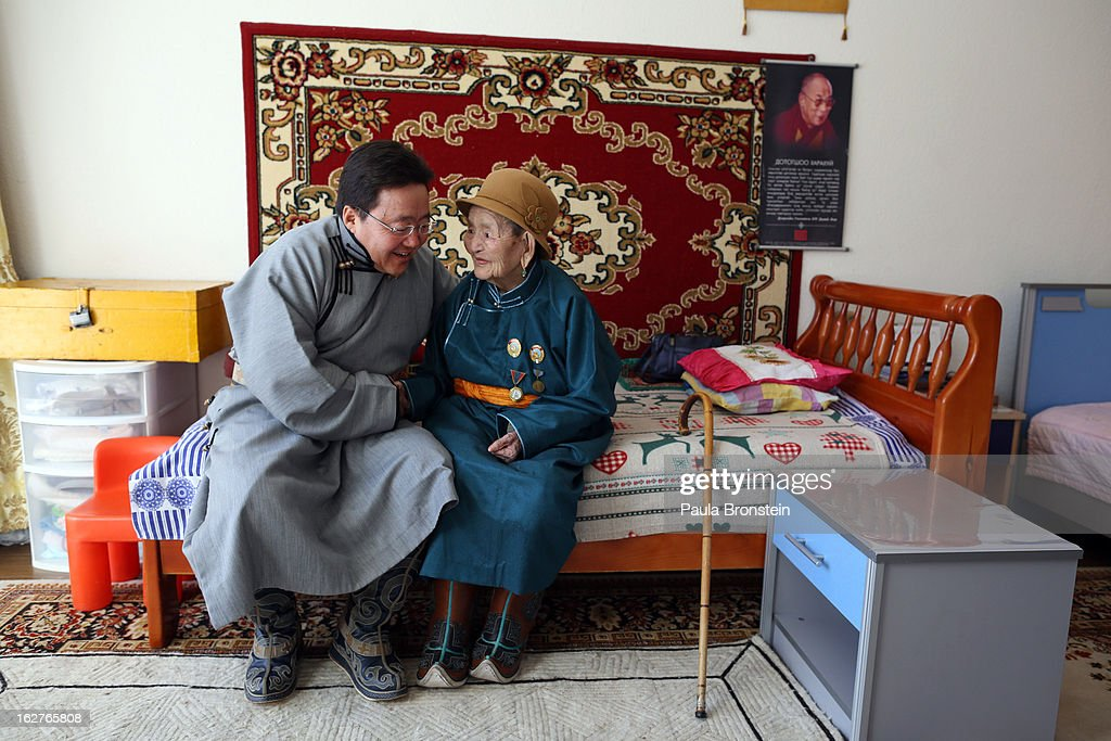 President <a gi-track='captionPersonalityLinkClicked' href=/galleries/search?phrase=Tsakhiagiin+Elbegdorj&family=editorial&specificpeople=5427078 ng-click='$event.stopPropagation()'>Tsakhiagiin Elbegdorj</a> visits his 93 year old mother, who lives with the family inside the presidential residence on October 26, 2012 in Ulaanbataar, Mongolia. President <a gi-track='captionPersonalityLinkClicked' href=/galleries/search?phrase=Tsakhiagiin+Elbegdorj&family=editorial&specificpeople=5427078 ng-click='$event.stopPropagation()'>Tsakhiagiin Elbegdorj</a> was elected on May 25, 2009, having previously served two terms as Prime Minister and holding the positions of Deputy Speaker and Majority Leader in Parliament. The First Lady, Bolormaa Khajidsuren, is a mother of 4 children, and the extended Presidential family includes 20 foster children coming from a variety of government children's homes. Some 100 years ago, Mongolia gained independence from Qing China, and more than 20 years ago it removed itself from the Soviet Bloc. Since then, the country has been undergoing massive social, economic and political changes. The Oyu Tolgoi copper and gold mine is Mongolia's biggest foreign investment project to date adding an estimated 35% value to the country's GDP. Mongolia is the most sparsely populated country on earth with fewer than 3 million people.