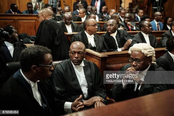 President Uhuru Kenyattas lawyer Ahmednasir Abdullahi and the Attorney General of Kenya Githu Muigai talk on November 20 2017 in Nairobi as the...