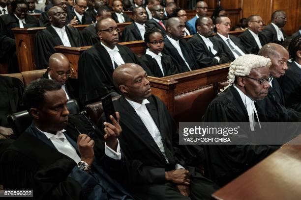 President Uhuru Kenyattas lawyer Ahmednasir Abdullahi gestures next to Attorney General of Kenya Githu Muigai on November 20 2017 in Nairobi as the...