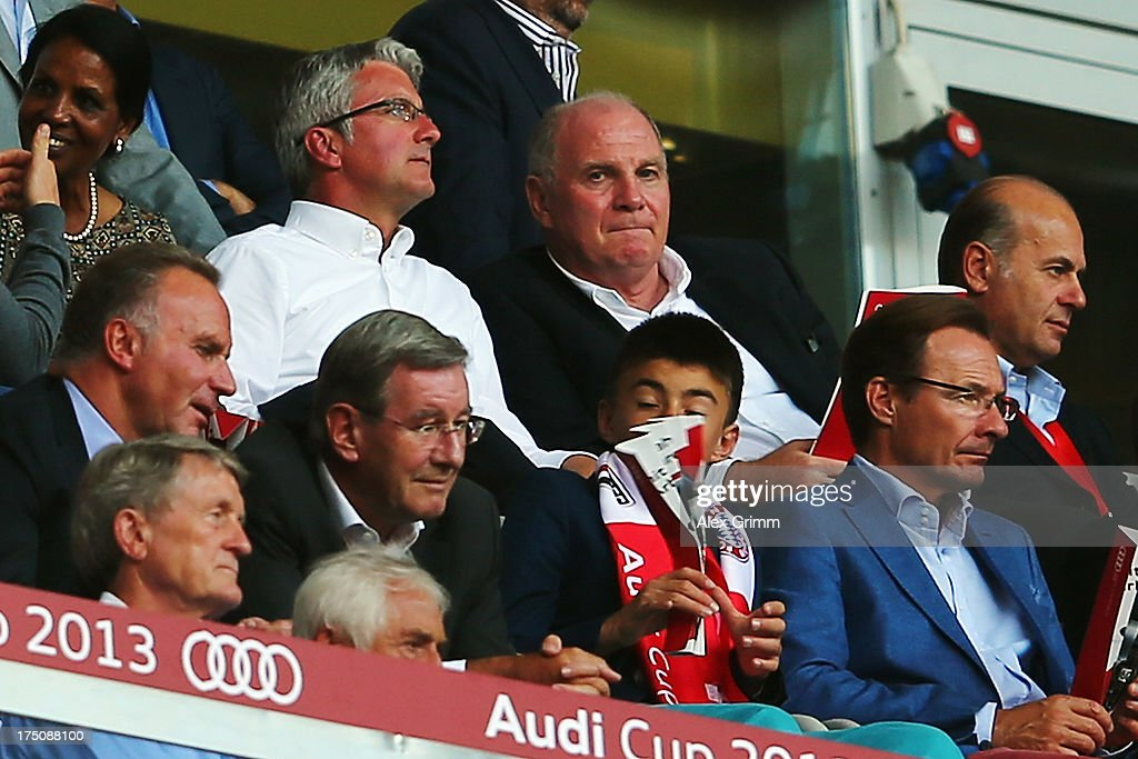 President <a gi-track='captionPersonalityLinkClicked' href=/galleries/search?phrase=Uli+Hoeness&family=editorial&specificpeople=634868 ng-click='$event.stopPropagation()'>Uli Hoeness</a> of Muenchen and <a gi-track='captionPersonalityLinkClicked' href=/galleries/search?phrase=Rupert+Stadler&family=editorial&specificpeople=870122 ng-click='$event.stopPropagation()'>Rupert Stadler</a>, CEO of Audi AG, attend the Audi Cup match between Manchester City and AC Milan at Allianz Arena on July 31, 2013 in Munich, Germany.