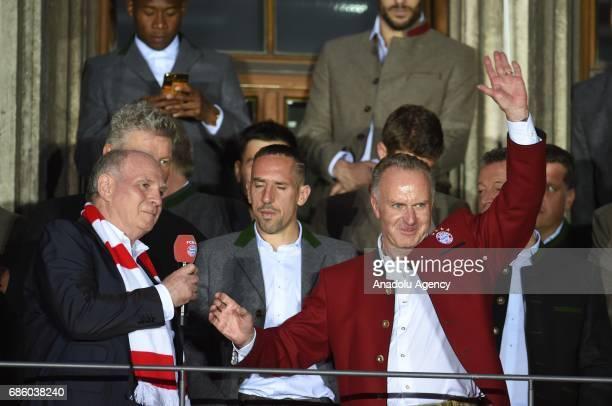President Uli Hoeness player Franck Ribery and CEO KarlHeinz Rummenigge of Bayern Munich celebrate winning the German soccer championship on a...