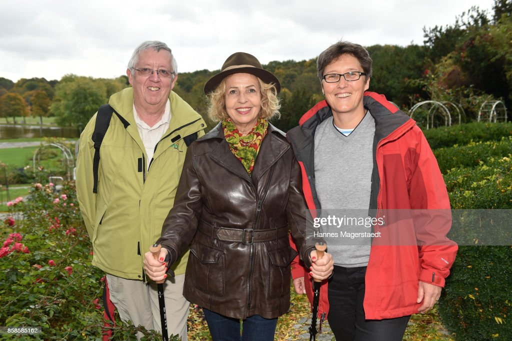 DVV President Uwe Kneibert, actress Michaela May and Anke Matter-Nolte during the charity walk for the Mukoviszidose e. V. at Westpark on October 7, 2017 in Munich, Germany.